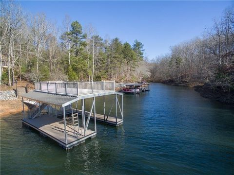 Located in Gainesville. One of the last estate sized lake lots (6.20 scres) on Lake Lanier. Very private with long Sunset Cove Views. Deep water cove was recently dredged and rip rapped. Graded building lot overlooking cove with almost new 32 x 32 al...