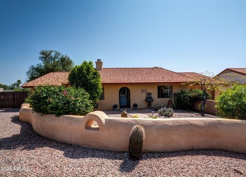 Genuine adobe home loaded with romantic charm, natural light, and southwest character. Like a boutique hotel, this home features a private oasis backyard with uninterrupted views of Four Peaks, saltwater pool, heated spa, citrus trees and a Koi pond ...