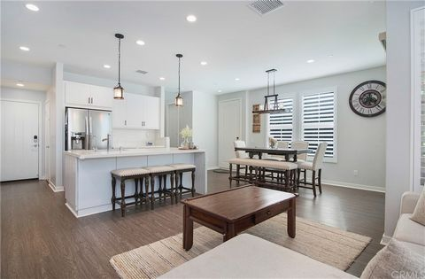 Welcome home to the most desirable floor plan at The Rowe in Baker Ranch. Located in THE BEST LOCATION in all of the community, this private end unit is beautiful, spacious, and turnkey with a large grassy area in the front, a large patio and only on...