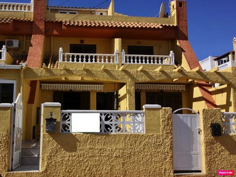 Great value 3 bedroom 1.5 bathroom townhouse for sale in Torrevieja, this property is second line to the beach and is only 150m away from the sea. As you enter the property through its gate, you are presented with a terrace, partly covered by an awni...