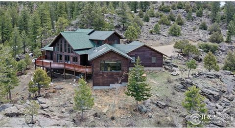 Private Luxury Mountain getaway located on over 4 acres. This quality Westover built home has four bedrooms with two beautiful master suites. This property DOES have a short term vacation rental permit. Amazing views of the Lumpy Ridge from the expan...