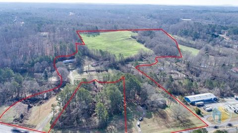 Prime location, located on GA Hwy 20 at the major intersection of GA Hwy 369. Beautiful 29.96 acres with possibilities galore! Future growth per county websites situate this property in a potential neighborhood village character area. Over 700 sqft o...