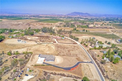 Beautiful new single story 4,735 sf hill top home with sweeping views of Temecula's Wine Country. This home has phenomenal rental income opportunities including an Accessory Dwelling Unit (ADU) with full kitchen, shower, bath and laundry space and sh...
