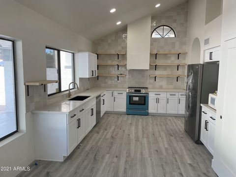 Completely remodeled, 4 bedroom, 3 baths house with gorgeous turf front and backyard with a big pool. Open floor plan. Amazing master bathroom with tub and shower. New appliances and modern fixtures throughout the house.
