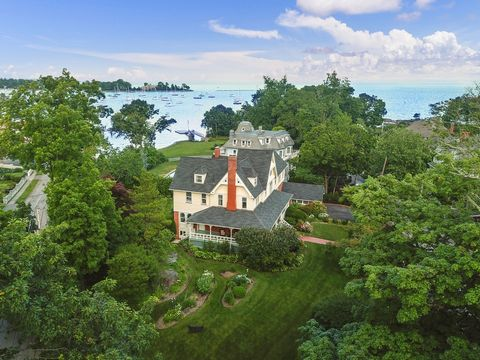 An exquisitely renovated Victorian beauty on a magical half-acre corner setting with spectacular views of Larchmont Harbor and Long Island Sound from multiple levels. Beautifully oriented toward the water, just steps to Manor Park, this sunlit home i...