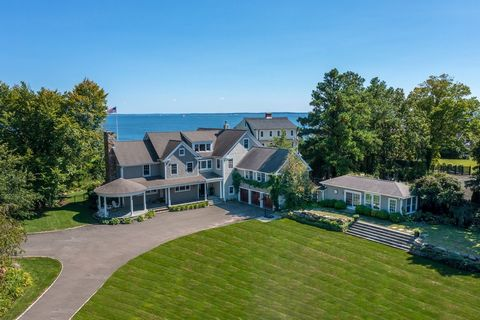 Exceptional six-bedroom resort-style home showcases stunning water views with pool, terrace, heated screened-in porch and guest house on .78 level acre in Old Greenwich. Wonderful indoor/outdoor living and entertaining options with four sets of Frenc...