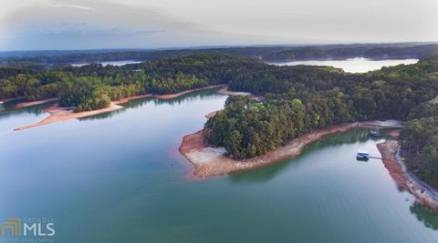 Located in Gainesville. One of 3 PREMIERE lake lots with good topography. 12 X 28 new boat slip in community dock included with this level, mature tree cover, deep water lot with long range views. Would be hard to find a better view on a gentle lot o...