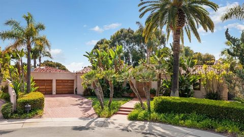 Stunning single level Spanish style home located on a large level lot with gorgeous ocean & canyon views. Enjoy inside outside living at is best as the family room, kitchen, dining, and entry open to a beautiful veranda with terracotta tile floors an...