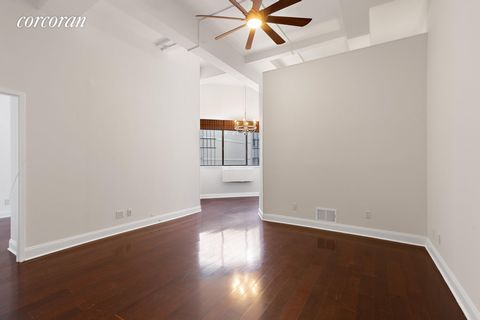 310 East 46th St #14A: Excellent condition, large space, towering ceilings! This is a 14th floor, flex-two bedroom apartment with 12.5 ft beamed ceilings and over-sized windows. Off of the entry foyer there is a separate updated kitchen with granite ...