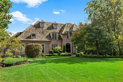 Luxurious living in this amazing Northfield jewel situated on a full acre of park-like setting, including a beautiful tennis court, (plus room for a pool). Minutes away from